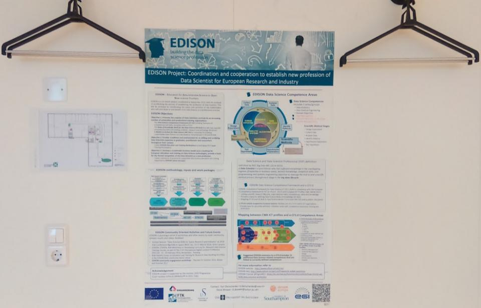EDISON poster on the wall at an event